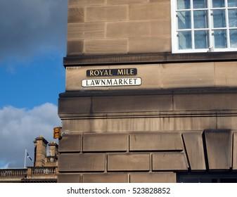 street sign on building side Royal Mile Lawnmarket Edinburgh Scotland United Kingdom