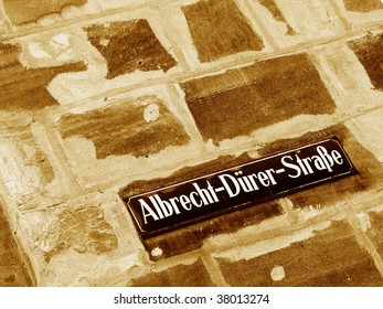 Street sign on a stone wall near the living place of Albrecht Duerer - Nuremberg, Germany. Named after the famous 15th-16th century german master painter, printmaker, woodcutter and theorist.