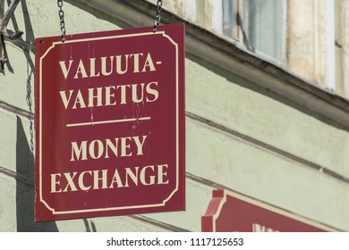 Street sign outside of money exchange shop in Tallinn, Estonia.