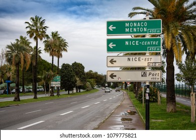 A street sign outside Nice airport directs traffic towards Monaco, Menton, the centre of Nice and Nice port