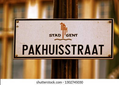 Street sign of Pakhuisstraat street with the coat of arms of Ghent, Belgium.