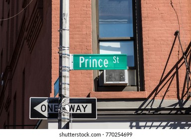 street sign prince  street at a crossing in Manhattan