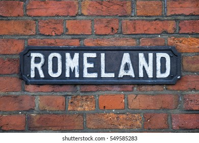 The street sign for Romeland in St. Albans, England.  The street name symbolises the historic links that St. Albans has to the Ancient Romans.