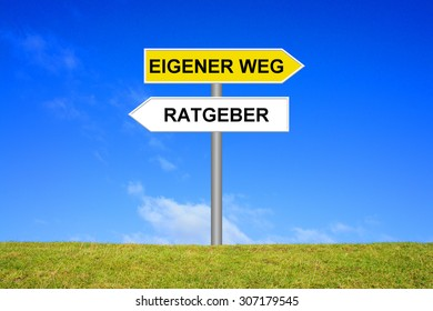 Street Sign showing counselor or own way in german language in front of blue sky on green grass