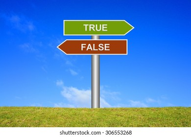 Street Sign showing true or false in front of blue sky on green grass