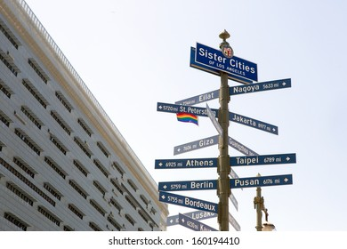 Street sign with the sister cities of Los Angeles and City Hall building