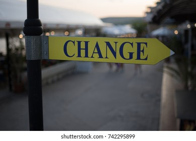 """Street signboard """"Change"""" on a blurred background. Concept: Time to change, Change the Way or a place to exchange money."""