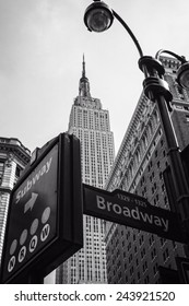 Street signs and Empire State Building B&W