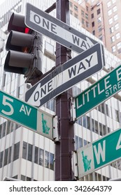 Street signs for Fifth Avenue and Litle Brazil street in Manhattan (New York City).