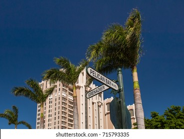 street signs in upscale pelican bay community of naples, florida, against clear blue sky, as of 2005
