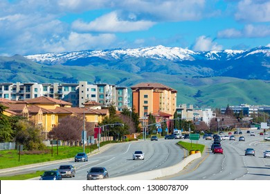 Street of Silicon valley in early spring with snow on top of nearby mountain. San Jose, USA