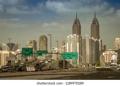Street with skyline Dubai arab view of  a crossroad with cars and palaces in background, remembering of buildings on a sunny day in United Arabian Emirates watching tall towers in middle-east of Asia