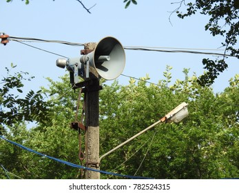 Street speaker on pole for public announcements and playing music