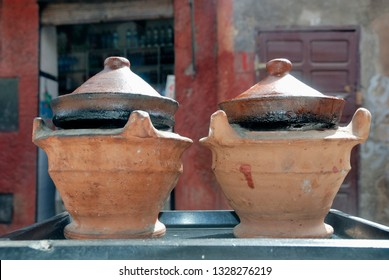 Street stable at the bazar preparing food in traditional ceramic tajine dishes, Morocco