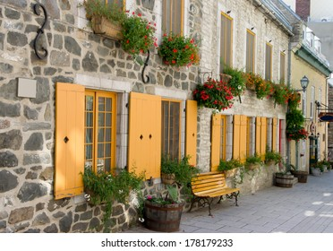 Street in a Staging Area with Bench, Flowerpot, typical of Old Quebec city.