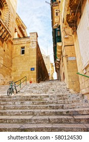 Street with staircase at the old city center of Valletta, Malta