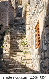 Street with stone stairs leading to the hill in Skradin town, Croatia