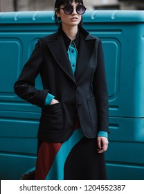 Street style fashion. Fashion & Style. The girl in a jacket and skirt on a blue background.