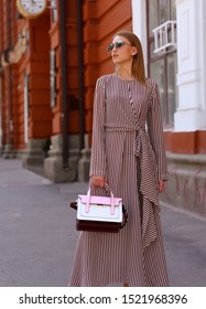 Street style fashion. Girl model in a dress.