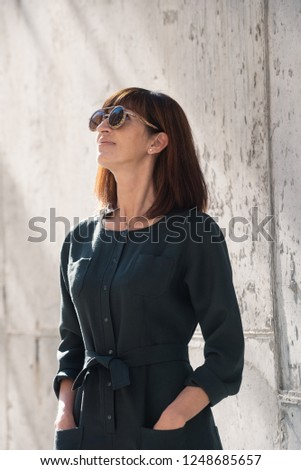 3a1e72ad4b18 Street style Fashion portrait pretty middle age woman in stylish dark  overall garment