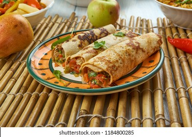 Street Style Veg Schezwan Aloo Frankie Roll, Schezwan cuisine, Asia  Chinese cuisine , Traditional assorted dishes, Top view.
