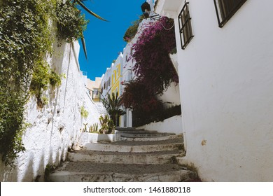 Street of Tanger with beautiful staircase, decorated houses and flowers blooming