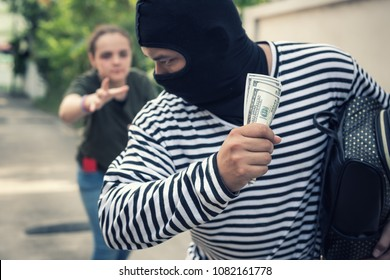 Street thief stealing money from tourist woman., Robber, Thief concept