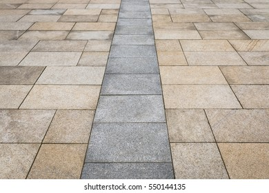 Street tiled stone pavement as background. Floor tiles texture. Close up old rock or stone texture, nature background, tile floor texture background wallpaper. Background for design pattern artwork.