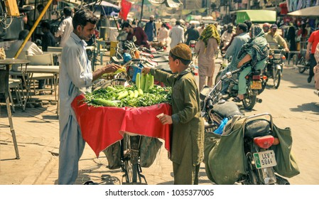 Street trade in Pakistan. The seller of greenery in Lahore. 04.23.2013