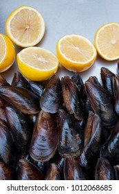 Street trade. A tray with mussels and lemons. Stuffed mussels. Top view of a mussel.