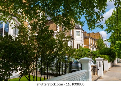 Street with traditional town houses at Hammersmith district in London. England