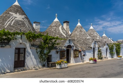 A street of traditional Trulli buildings in Alberobello, Bari, Italy in sumertime