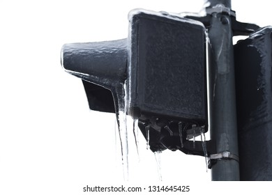 Street traffic lights covered in ice after frozen rain phenomenon