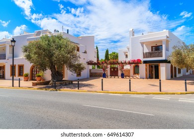 Street with typical architecture of Sant Carles de Peralta village with whitewashed houses, Ibiza island, Spain