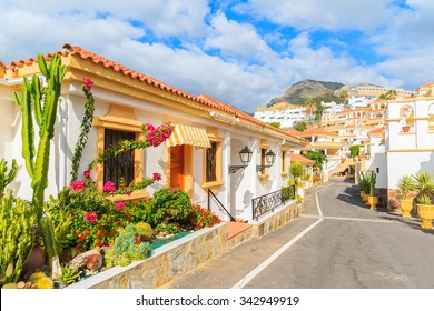 Street with typical Canary style holiday apartments in Costa Adeje, Tenerife, Canary Islands, Spain