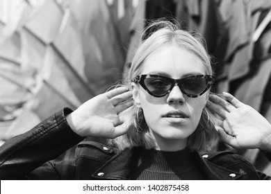 Street urban close up portrait of young sexy attractive stylish girl in fashionable sun glasses. Beauty, street, city, freedom concept. Black and white photo