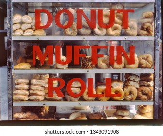 Street Vendor Donut, Muffin and Roll Cart, at midtown Manhattan, NYC , USA