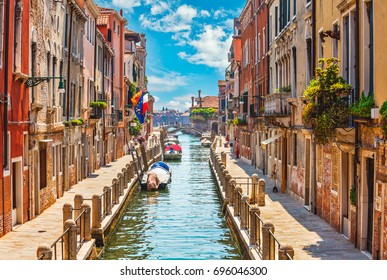 Street in Venice with canal boat and blue sky white cloud picturesque landscape Italy.