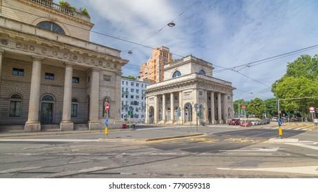 A street view of beautiful historic landmark - Porta Venezia timelapse hyperlapse (crossroad on Avenue Buenos Aires and street Bastioni di Porta Venezia). Milan, Italy. Traffic on the road. Blue