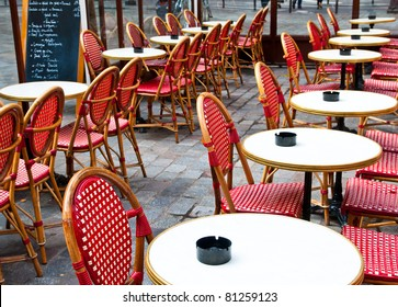 Street view of a Cafe terrace with empty tables and chairs,paris France