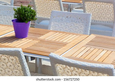 Street view of a Cafe terrace with tables and chairs