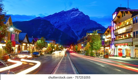 Street view of famous Banff Avenue at twilight time. Banff is a resort town and one of Canada's most popular tourist destinations.