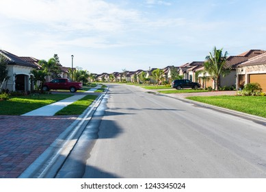 Street view of a Florida golf community and residential neighborhood in Bonita Springs