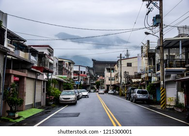 Street view of Hualien City, Taiwan with the mountains of Taroko Gorge in the background. Gateway city to the famous national park and popular tourist destination.