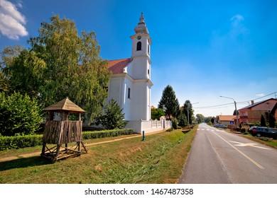 Street view of Karanac church and historic architecture, ethno village in Baranja region of Croatia