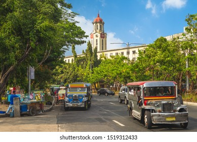 street view of manila with jeepney and clock tower