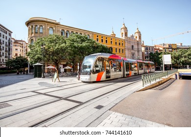 Street view with modern tram in Zaragoza city during the sunny day in Spain