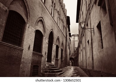 Street view with old buildings in Siena, Italy.