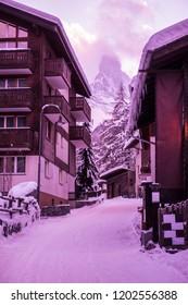 street view of old village with Matterhorn peak background in Zermatt, Switzerland