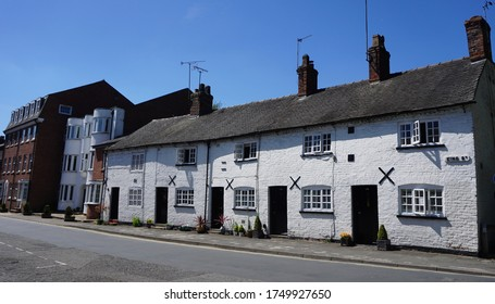 Street view with old white cottages in Knutsford Cheshire England on a sunny day June 2020